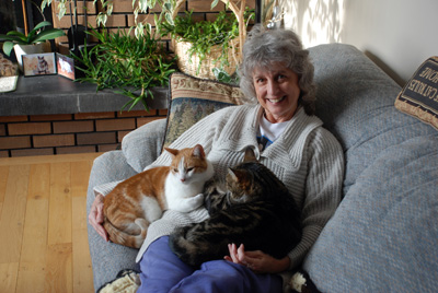 Marlene with ET (orange cat) and Moxie.