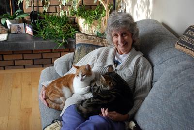 Marlene with ET (orange cat) and Moxie.